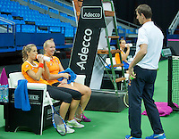 Moskou, Russia, Februari 4, 2016,  Fed Cup Russia-Netherlands,  Dutch team practise doubles   Kiki Bertens and Arantxa Rus (L) with captain Paul Haarhuis<br /> Photo: Tennisimages/Henk Koster