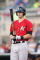 Louie Lechich (21) of the Kannapolis Intimidators checks his bat before stepping up to the plate against the Delmarva Shorebirds at CMC-Northeast Stadium on June 6, 2015 in Kannapolis, North Carolina.  The Shorebirds defeated the Intimidators 7-2.  (Brian Westerholt/Four Seam Images)