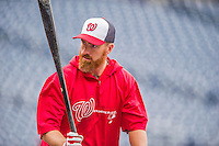 5 April 2014: Washington Nationals first baseman Adam LaRoche awaits his turn in the batting cage prior to facing the Atlanta Braves at Nationals Park in Washington, DC. The Braves defeated the Nationals 6-2 to take the second game of their 3-game series. Mandatory Credit: Ed Wolfstein Photo *** RAW (NEF) Image File Available ***