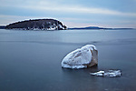 "A solitary glacial erratic, called ""Balance Rock,"" sits in the calm waters of Frenchman Bay in Bar Harbor, Maine, USA"