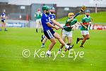St Brendan's Kevin Orpen clears his defence as Crotta's Declan O'Donoghue attempts to block his effort in the County Senior Hurling Championship quarter final