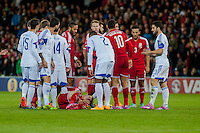 Wednesday 4th  December 2013 Pictured: Gareth Bale of Wales  lies injured in the floor <br /> Re: UEFA European Championship Wales v Cyprus at the Cardiff City Stadium, Cardiff, Wales, UK