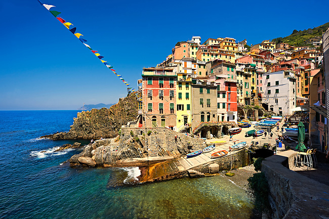 Photo of the colorful houses of the fishing port of Riomaggiore, Cinque Terre National Park, Liguria, Italy