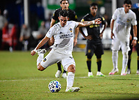 LAKE BUENA VISTA, FL - JULY 18: Cristian Pavón #10 of LA Galaxy takes a penalty shot during a game between Los Angeles Galaxy and Los Angeles FC at ESPN Wide World of Sports on July 18, 2020 in Lake Buena Vista, Florida.