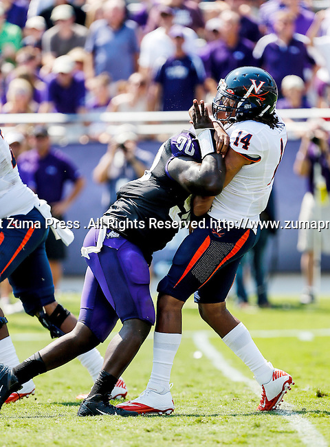 TCU Horned Frogs defensive end Stansly Maponga (90) and Virginia Cavaliers quarterback Phillip Sims (14) in action during the game between the Virginia Cavaliers and the TCU Horned Frogs  at the Amon G. Carter Stadium in Fort Worth, Texas. TCU defeats Virginia 27 to 7...