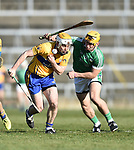 Conor Mc Grath of  Clare  in action against Tom Morrissey of  Limerick during their NHL quarter final at the Gaelic Grounds. Photograph by John Kelly.