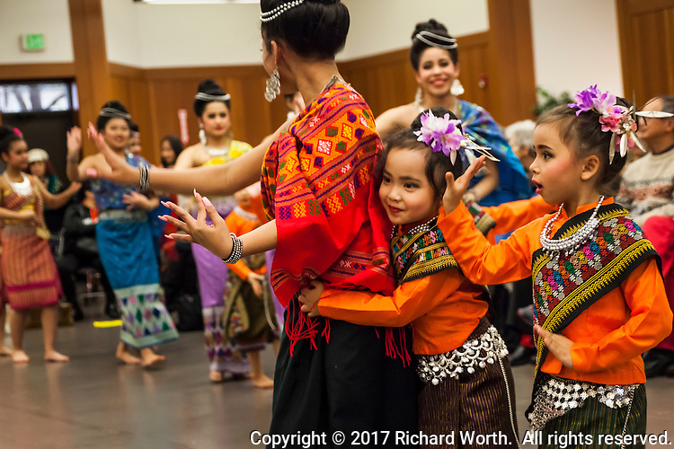Dancers hug and take the floor during the Lunar New Year Celebration at San Leandro Library.