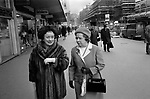 Two middle aged ladies smartly dressed out shopping one is wearing a fur overcoat. 1976 London Victoria Street.  1970s UK