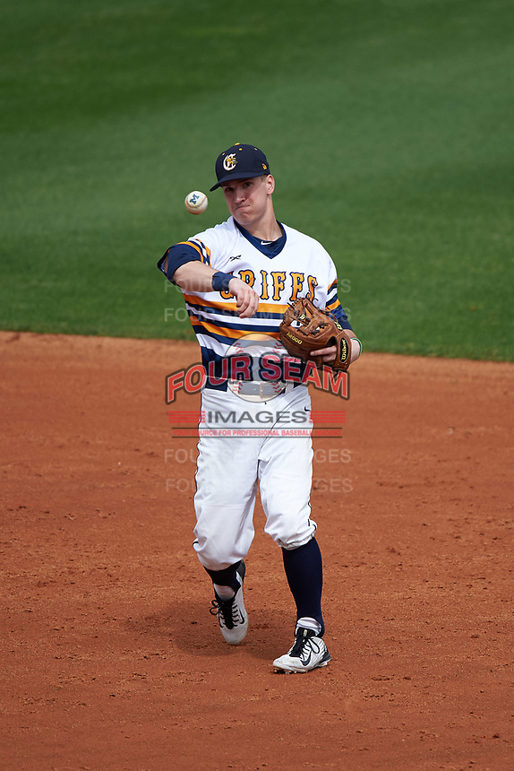 Canisius College Golden Griffins second baseman Jake Lumley (3) throws to first base during the first game of a doubleheader against the Michigan Wolverines on February 20, 2016 at Tradition Field in St. Lucie, Florida.  Michigan defeated Canisius 6-2.  (Mike Janes/Four Seam Images)