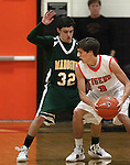 James Sandoval, with Manogue, defends against Douglas' Nick Maestretti during a boys basketball game between Bishop Manogue and Douglas High in Minden, Nev., on Thursday, Dec. 22, 2011..Photo by Cathleen Allison