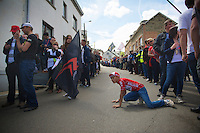 young fan tries to see if the riders are already coming up the Côte de Saint-Roche<br /> <br /> Liège-Bastogne-Liège 2014