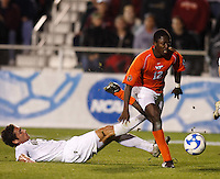 Wake Forest Demon Deacons defender Julian Valentin (4) attempts a tackle on Virginia Tech Hokies forward Patrick Nyarko (12) during an NCAA College Cup semi-final match at SAS Stadium in Cary, NC on December 14, 2007. Wake Forest defeated Virginia Tech 2-0.