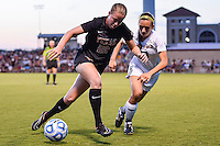 Texas forward Katie Gernsbacher (22) cuts around and Texas State forward Kira Zapalac (23) during an NCAA soccer game, Sunday, September 21, 2014 in San Marcos, Tex. Texas defeated Texas State 2-0. (Mo Khursheed/TFV Media via AP Images)