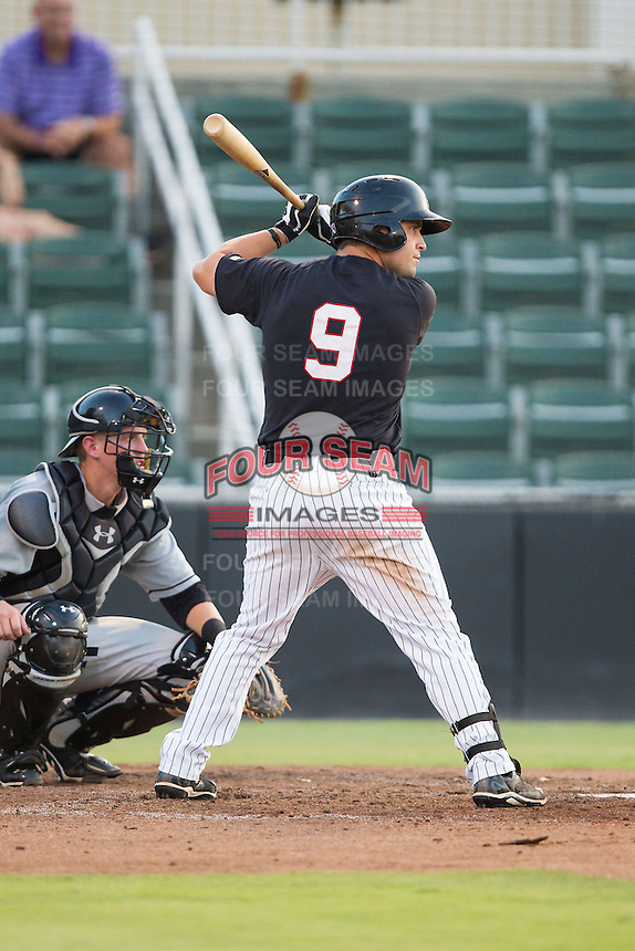 Nolan Early (9) of the Kannapolis Intimidators at bat against the Delmarva Shorebirds at CMC-NorthEast Stadium on July 1, 2014 in Kannapolis, North Carolina.  The Intimidators defeated the Shorebirds 5-2. (Brian Westerholt/Four Seam Images)