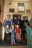 Three Chechen man with their children in the corridor by the entry of URiC Wola Center in Warsaw..Portraits on the wall above them: The former Chechen President Aslan Maskhadov (Left) and the new Chechen President, Abdul Halim Saydullayev (Right)..-For security reason, the names of the adult asylum seeker have been change. .-Article 9 of the Act of 13 June 2003 on grating protection on the Polish territory (Journal of Laws, No 128, it. 1176) personal data of refugees are an object of particular protection..-Cases where publication of a picture or name of asylum seeker had dramatic consequences for this persons and is family back in Chechnya. .Please have safety of those people in mind. Thank you.
