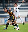 Alloa's Darryl Meggatt and Raith Rovers' Grant Anderson challenge for the ball.