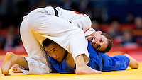 29 JUL 2012 - LONDON, GBR - Ebinuma Masashi (JPN) (left) of Japan attempts to escape an attack by Pawel Zagrodnik (POL) (right) of Poland during their men's -66kg category bronze medal match at the London 2012 Olympic Games judo at the ExCel Exhibition Centre in London, Great Britain (PHOTO (C) 2012 NIGEL FARROW)