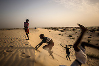 Children play on a sand dune near the town of Gao, located on the Niger River. /Felix Features