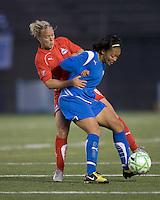 Boston Breakers midfielder-forward Angela Hucles (16) traps ball as Washington Freedom midfielder Lori Lindsey (6) defends. The Boston Breakers tied the Washington Freedom, 1-1, at Harvard Stadium on May 17, 2009.