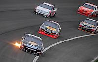 Feb 22, 2009; Fontana, CA, USA; NASCAR Sprint Cup Series driver Matt Kenseth leads a pack of cars during the Auto Club 500 at Auto Club Speedway. Mandatory Credit: Mark J. Rebilas-