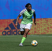 GRENOBLE, FRANCE - JUNE 12: Desire Oparanozie #9 of the Nigerian National Team dribbles during a game between Korea Republic and Nigeria at Stade des Alpes on June 12, 2019 in Grenoble, France.