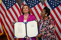 Speaker of the United States House of Representatives Nancy Pelosi (Democrat of California), left, is joined by United States Representative Sheila Jackson-Lee (Democrat of Texas), right, as they pose for a photo following a bill enrollment photo op for H.R. 1652 - VOCA Fix to Sustain the Crime Victims Fund Act of 2021, at the US Capitol, in Washington, DC, Wednesday, July 21, 2021. Credit: Rod Lamkey / CNP /MediaPunch
