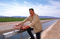 Mojave Nation farmer watering his fields. Fort Mojave, California