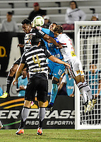 Orlando, FL - Saturday Jan. 21, 2017: São Paulo goalkeeper Sidão (12) punches the ball away from Corinthians left back Moisés (6) during the second half of the Florida Cup Championship match between São Paulo and Corinthians at Bright House Networks Stadium. The game ended 0-0 in regulation with São Paulo defeating Corinthians 4-3 on penalty kicks.