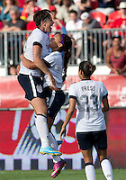 02 June 2013: U.S. Women's National Team player Abby Wambach #20 celebrates a goal by U.S .Women's National Team player Sydney Leroux #2 during an international friendly soccer match between the U.S Women's National Team and the Canadian Women's National Team at BMO Field in Toronto, Ontario Canada.<br /> The U.S. National Women's Team won 3-0.
