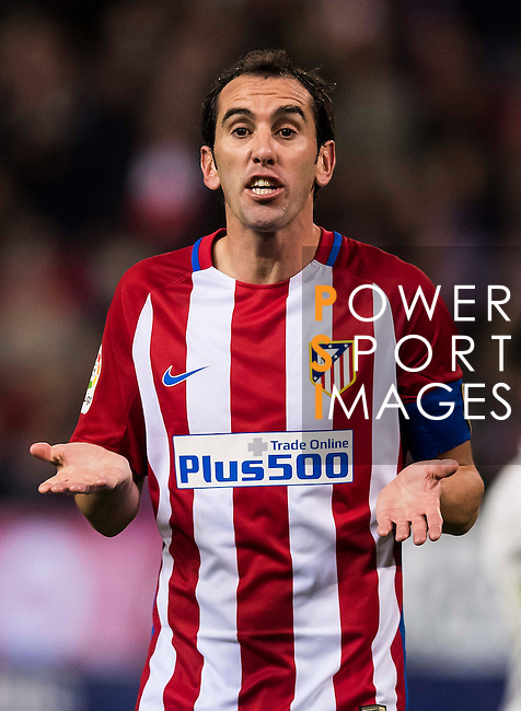 Diego Roberto Godin Leal of Atletico de Madrid reacts during their La Liga match between Atletico de Madrid and Real Madrid at the Vicente Calderón Stadium on 19 November 2016 in Madrid, Spain. Photo by Diego Gonzalez Souto / Power Sport Images