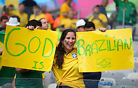 A Brazil supporter holds banners saying 'God is Brazilian'