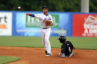 Kingsport Mets shortstop Amed Rosario #1 completes the turn on a double around a hard sliding Thurman Hall #1 during a game against the Bristol White Sox at Hunter Wright Stadium on August 15, 2013 in Kingsport, Tennessee. The White Sox won the game 4-2. (Tony Farlow/Four Seam Images)