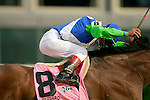Barbaro races down the home stretch as jockey Edgar Prado check to see who is behind him during the 132nd running of the Kentucky Derby at Churchill Downs in Louisville, Kentucky on May 6, 2006..