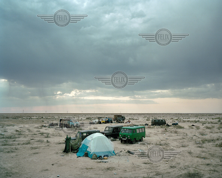 A small settlement of trucks and tents collect in a remote part of the Kazakh desert to work at the recently constructed Kokaral Dyke. Men come from all around the area to fish here, camping for months at a time to profit from the rising waters.