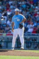 North Carolina Tar Heels pitcher Taylore Cherry #48 pitches during Game 3 of the 2013 Men's College World Series between the North Carolina State Wolfpack and North Carolina Tar Heels at TD Ameritrade Park on June 16, 2013 in Omaha, Nebraska. The Wolfpack defeated the Tar Heels 8-1. (Brace Hemmelgarn/Four Seam Images)