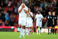 Sunday, 19 October 2014<br /> Pictured: Ashley Williams of Swansea City looks dejected as he leaves the pitch at full time<br /> Re: Barclay's Premier League, Stoke City FC v Swansea City FC v at Britannia Stadium, Stoke, Staffordshire,UK.