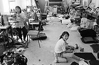 - Chinese immigrants in Campi di Bisenzio(Firenze), leather laboratory<br /> <br /> - immigrati cinesi a Campi di Bisenzio (Firenze), laboratorio di pelletterie