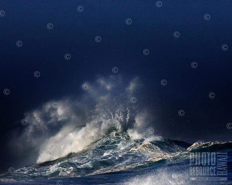 World famous shore break winter waves (20+ foot) at Waimea Bay on the North Shore of Oahu, Hawaii.