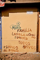 """Chile, Aftermath of the tsunami in the area of Consitucion. """"Loyola Cancino family, we are alive and living in the beck of the house"""""""
