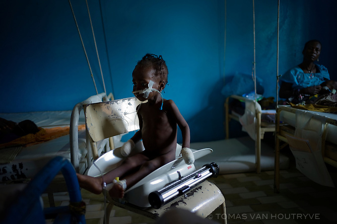 A malnourished child is weighed on a scale inside the regional hospital in Maradi, Niger on Sept. 23, 2010. The population of Niger is hit yearly with a chronic food crisis that generally peaks between May and September.