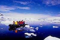Zodiac with Tourists Exploring Icebergs and Glaciers at Prospect Point on the Antarctica Peninsula