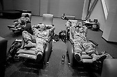 Columbus, Georgia.USA.March 12, 2007..450 soldiers of the third Infantry, third brigade are deployed to Iraq from Fort Benning, Georgia. Many of the men are being deployed for their second or third tour of duty...After separating from their families soldiers spent their last few hours in a hanger at the airport waiting for the plane to fly them into Iraq.