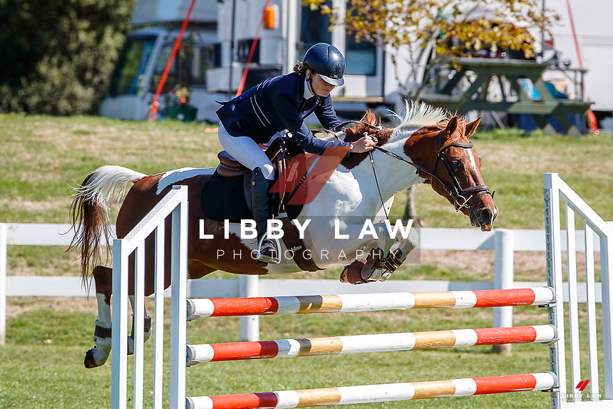 NZL-Alice Crofskey rides Alaska Rose. Final-1st. Class 26: Pony 1.05m Ranking Class. 2021 NZL-Easter Jumping Festival presented by McIntosh Global Equestrian and Equestrian Entries. NEC Taupo. Saturday 3 April. Copyright Photo: Libby Law Photography
