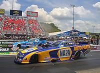 Jun 21, 2015; Bristol, TN, USA; NHRA funny car driver Ron Capps (near lane) races alongside John Force during the Thunder Valley Nationals at Bristol Dragway. Mandatory Credit: Mark J. Rebilas-