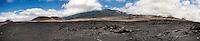 A view of Mauna Kea Volcano with lava fields along Saddle Road, Big Island.