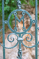 A garden wrought iron gate with the letter M in a circle Dubrovnik, new city. Dalmatian Coast, Croatia, Europe.
