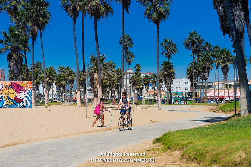 Boy on a bike In Venice Beach, Los Angeles, California