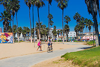 Boy on a bike In Venice Beach, Los Angeles, California