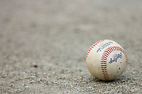 A South Atlantic League baseball sits on the warning track behind home plate at L.P. Frans Stadium August 9, 2009 in Hickory, North Carolina. (Photo by Brian Westerholt / Four Seam Images)