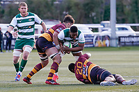 Simon UZOKWE (20) of Ealing Trailfinders is tackled during the Greene King IPA Championship match between Ealing Trailfinders and Ampthill RUFC being played behind closed doors due to the COVID-19 pandemic restrictions at Castle Bar , West Ealing , England  on 13 March 2021. Photo by David Horn.